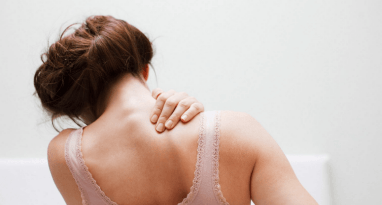 woman experiencing pain in shoulders during pregnancy