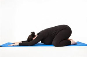 Child's stretch pose for tailbone pain in pregnancy.
