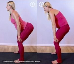 Standing cat-cow pose for tailbone pain in pregnancy.